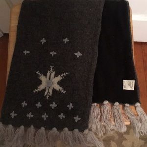 Gray knit scarf with snowflake and tassel detail